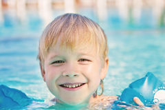 Happy child in the swimming-pool Royalty Free Stock Images