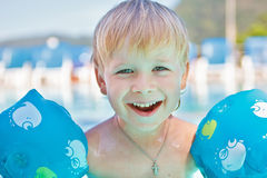 Happy child in the swimming-pool Stock Photography