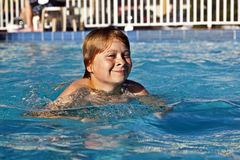 Happy child is swimming in the pool Royalty Free Stock Photography