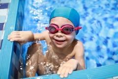 Happy child in swimming pool. Portrait of happy child in the swimming pool stock photos