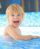 Happy child in swimming pool Royalty Free Stock Images