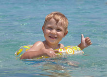 Happy child swimming in the sea. Royalty Free Stock Image
