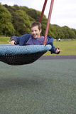 Happy child on the swing Stock Photo