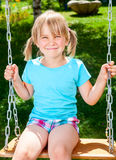 Happy child on a swing Royalty Free Stock Photo