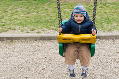 Happy child on swing. In pablic park stock photos