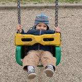 Happy child on swing. In pablic park stock images