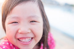 Happy child take a selfie. In the park, asian Stock Photography