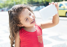 Happy child taking selfie with mobile phone Royalty Free Stock Photography