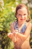 Happy child taking shower Stock Photo