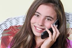 Happy child talking on cell phone Royalty Free Stock Images