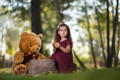 Happy child with a teddy bear Stock Photography