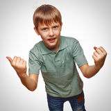 Happy child teen excited teenage boy shows hand so Royalty Free Stock Photos