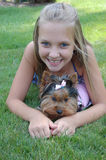 Happy child teen girl smiling with pet puppy. My daughter and her puppy Royalty Free Stock Photo