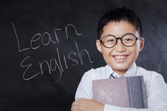 Happy child with text Learn English Stock Images