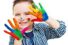 Happy child with their hands all painted. Playing royalty free stock image