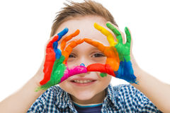 Happy child with their hands all painted. Playing royalty free stock photo