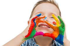 Happy child with their hands all painted. Playing stock photography