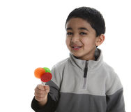 Happy Child with Three Colorful Lollipops Stock Photography