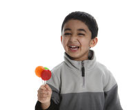 Happy Child with Three Colorful Lollipops Royalty Free Stock Photos