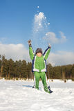 Happy child throwing up snow Royalty Free Stock Photography