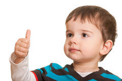 Happy child with thumb up. A cheerful kid is holding his thumb up; isolated on the white background (Shallow DOF - Focus on the left eye Royalty Free Stock Photo
