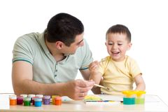 Happy child toddler and dad painting isolated on white stock photo