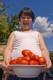 Happy child with tomatoes Stock Image