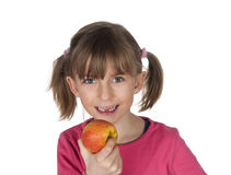 Happy child with tooth gap and apple Royalty Free Stock Photos
