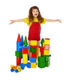 Happy child in a toy castle. Isolated on white background Stock Photo