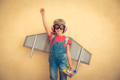Happy child with toy jetpack playing at home Stock Images