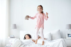 Happy child with toy and parents in bed at home royalty free stock photo