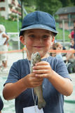 Happy child with a trout Stock Images
