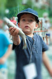 Happy child with a trout Stock Image