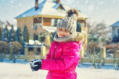 Happy child on a walk in winter day royalty free stock image