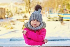 Happy child on a walk in winter day royalty free stock photos