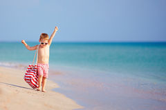 Happy child walking the summer beach Stock Image