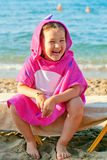 Happy child wearing a beach towel Stock Photo