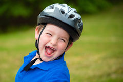 Happy child wearing a bike helmet Royalty Free Stock Photos