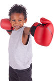 Happy child wearing boxing gloves Stock Photos