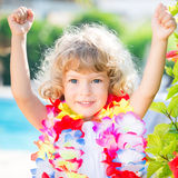 Happy child wearing hawaiian flowers garland Stock Image