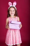 Happy child is wearing pink dress and bunny ears Royalty Free Stock Photography