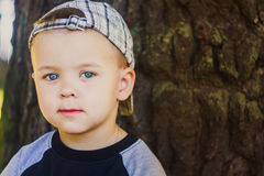 Happy child wearing striped cap Royalty Free Stock Photography