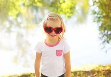 Happy child wearing a sunglasses having fun in summer Stock Images