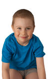 Happy child on white. Happy smiles child in a blue T-shirt on white royalty free stock photos