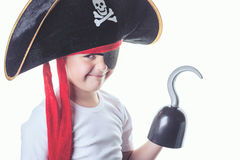 Happy child who disguises. Smiling boy dressed as pirate Royalty Free Stock Images