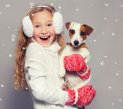 Happy child in winter clothes with dog Stock Image