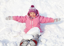 Happy child in winter park Royalty Free Stock Image