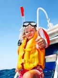 Happy child on yacht. Royalty Free Stock Images