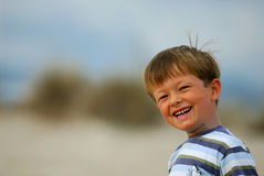 Happy childhood. Young boy is laughing at his father royalty free stock image