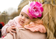 Happy childhood. Beautiful baby girl on her mother's shoulder Royalty Free Stock Image